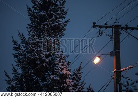 Old Power Electric Line And A Street Lamp Light, Power Supply Cable, With Obsolete Connection System