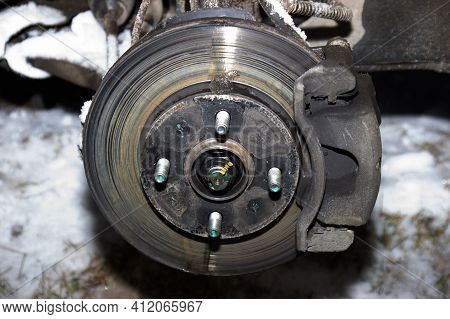 Braking System With Disk Open For Repair Maintenance And Service. Close Up Disk Brake Of Car.