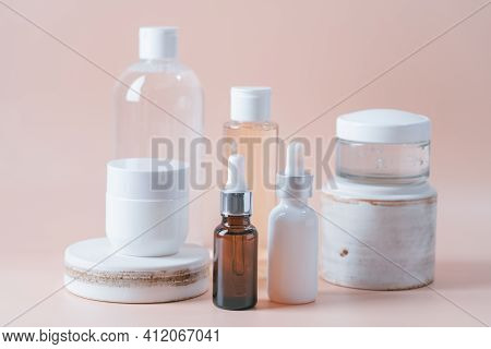 Set Of Natural Cosmetics For Face Care Serum, Cream And Micellar Water On Pastel Blurred Background
