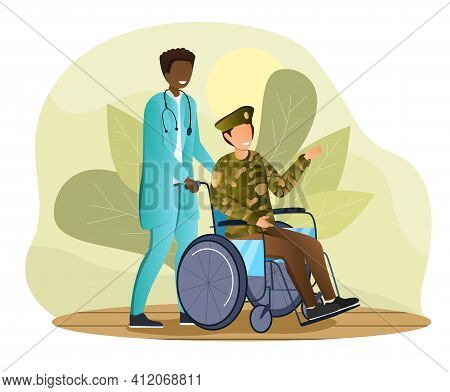 Male Nurse And Veteran Soldier In Military Uniform On A Wheelchair. Smiling Doctor Rolls A Patient W