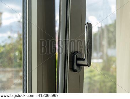 Metal Or Pvc Window Vertical Open Closeup View. Tilt And Turn Grey Color Aluminum Window, Fresh Air