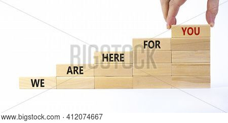 Support Symbol. Wooden Blocks With Words 'we Are Here For You'. Businessman Hand. Beautiful White Ba