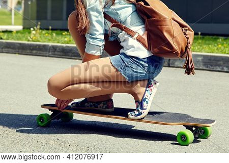 Skater With A Longboard Closeup. Trendy Casual Hipster Person A Skateboard.