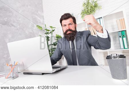 Dealing With Anger At Work. Bearded Man Feel Anger At Work. Businessman Show Fist In Anger. Anger Ma