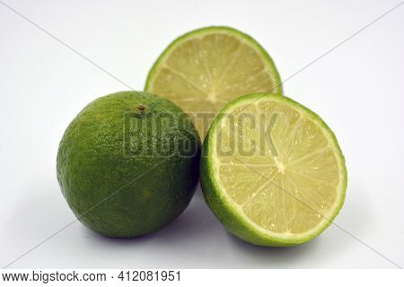 Healthy Ripe Delicious Fruits For Human Health. Juicy Fruits Of Green Lime. Two Halves Of A Cut Lime