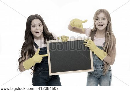 A Little Help For Keeping Things Tidy. Adorable Tidy Schoolgirls In Rubber Gloves Pointing At Tidy B