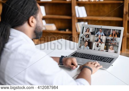 Back View On The Laptop Screen With Many Profiles On It, An African-american Guy Is Using Computer A