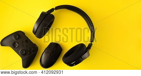 Gamer Flat Lay. Gaming Accessories On Yellow Background With Copy Space.gamer Gadgets.