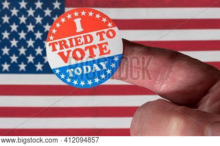 Finger With I Voted Button In Front Of Voting Stickers Given To Us Voters. This Illustrates State La