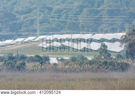 Solar Panels On The Slopes Of A Hill, Green, Renewable And Natural Energy