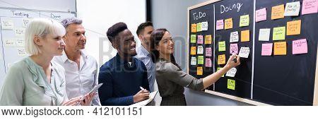Agile Business Team Using Kanban Task Board