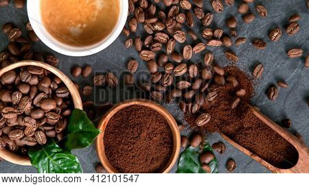 Roasted Coffee Beans, still-life on Black Stone Background, close-up.