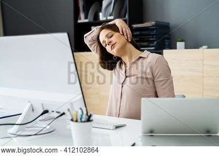 Woman Stretching At Office Desk. Worker Stretch Workout