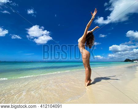 Sexy Beautiful Caucasian Woman Posing In White Bikini At The Sea Coast. Exotic Country Travel And Re