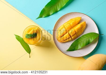 Ripe Mango Fruit And Fresh Mango Smoothie In A Glass On Color Background, Tropical Drink