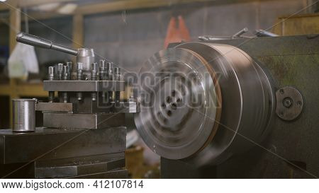 Professional Machinist Operating Lathe Grinding Metal Machine Metalworking Industrial Manufacturing