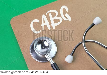 Stethoscope And Brown Board Written With Cabg Stands For Coronary Artery Bypass Grafting