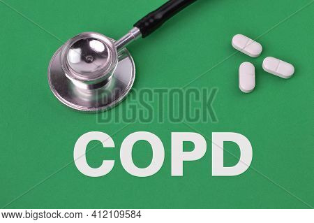 Pill Capsules And Stethoscope Over Green Background Written With Copd Stands For Chronic Obstructive