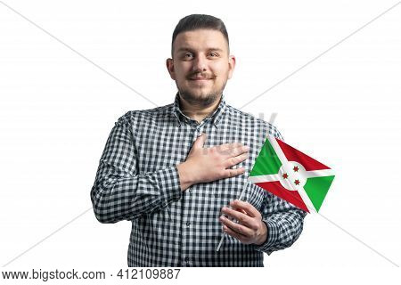 White Guy Holding A Flag Of Burundi And Holds His Hand On His Heart Isolated On A White Background W
