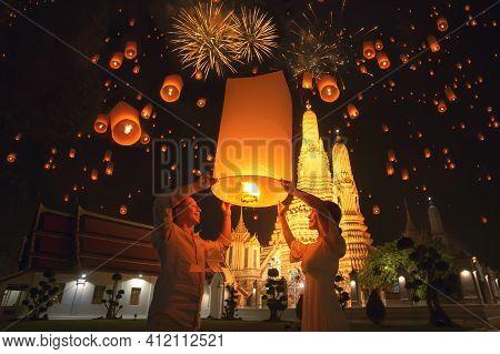 Traveler Couple Enjoy Yeepeng Floating Lantern In Loi Kratong Festival At Arun Temple, Bangkok City,