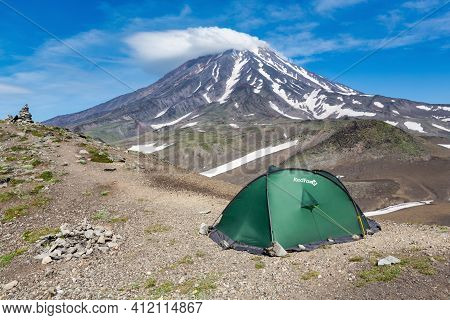 Green Tourist Tent Red Fox For Camping And Travel Standing In Mountain On Background Of Volcanic Lan