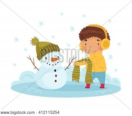 Happy Boy In Earmuffs Building Snowman And Dressing Him Up In Scarf And Hat Enjoying Winter Vector I