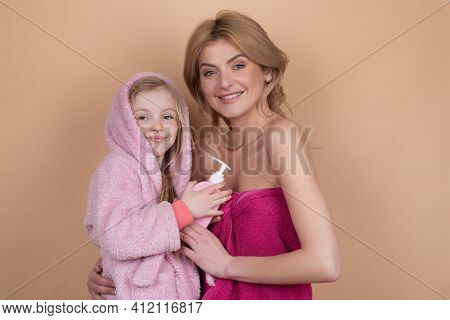 Family Spa. Woman And Girl With Towels. Kids Bathing. Baby Hygiene. Hygienic Products In Bathroom. L