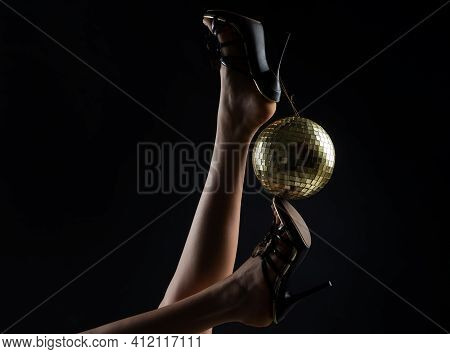 Celebrating. Disco Ball On High Heels. Party Legs. Holidays Event. Woman Heels With Gold Disco Ball.