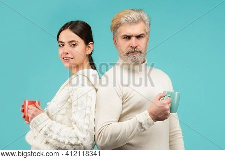 Family Coziness Concept. Happy Couple At Casual Morning With Cup Of Coffee Or Tea. Enjoying Nice Fam