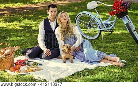 Couple In Love Enjoy Picnic Time. Spring Date. Playful Couple Having Picnic In Park. Romantic Date.