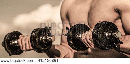 Dumbbell In Hands, Closeup. Man Training With Dumbbells. Dumbbell. Muscular Bodybuilder Guys, Exerci