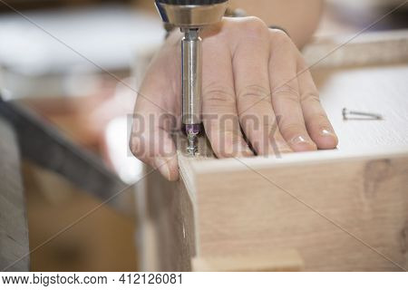 Drilling In A Joinery Or Carpentry