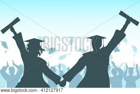 Graduates Girl And Guy Hold Hands With Diploma On Background Of Cheerful Crowd Of Graduates Throwing