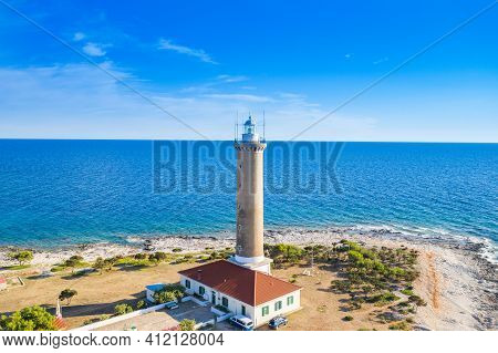 Old Lighthouse On The Shore Of The Island Of Dugi Otok, Adriatic Sea Horizon In Background, Beautifu