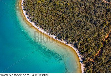 Adriatic Coastline In Croatia, Dugi Otok Island. Pine Woods And Long Beaches. Overhead View From Dro