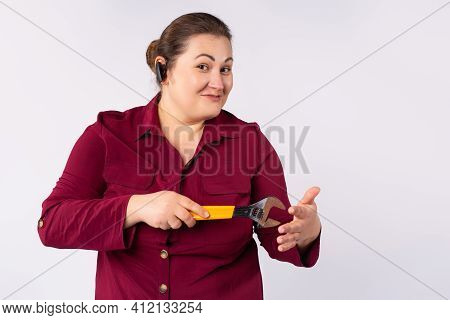 Female Mechanic Holding Adjustable Wrench Isolated On Grey Background With Side Space For Motivation