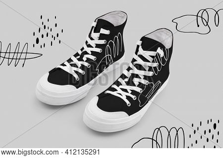 Black high top sneakers with line art graphics unisex footwear fashion