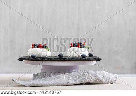 Meringue Cake With Fresh Blueberry And Strawberry. Cake Anna Pavlova.