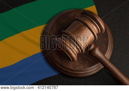 Judge Gavel And Flag Of Gabon. Law And Justice In Gabon. Violation Of Rights And Freedoms.