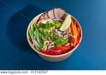 Traditional Vietnamese Pho-bo Soup With Beef. In A Food Delivery Plate. Close-up. View From Above. I
