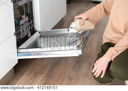 Woman Putting Soap In The Dishwasher. Cleaning And Hygiene Concept.