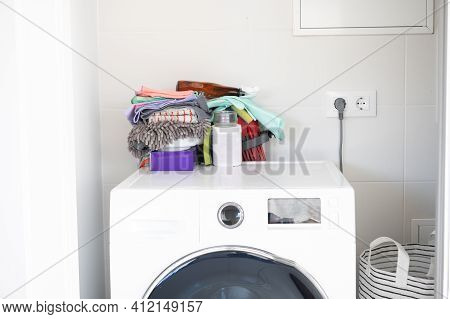 New Washing Machine Clean With Detergents, Soaps And Cleaning Utensils On Top. Clean House