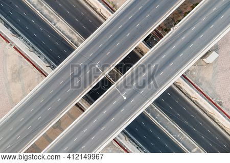 Aerial View Of Empty Road Interchange Or Urban Highway Intersection. Junction Network Of Transportat