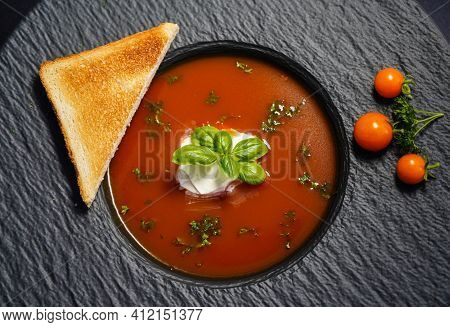 A Soup Of Red Round Tomatoes Solanum Lycopersicum With Herbs