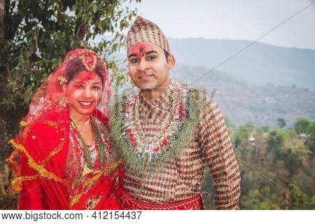 Happy Asian Newlywed Hindu Bride And Groom Posing For Photograph On The Wedding Day. Hindu Bridegroo