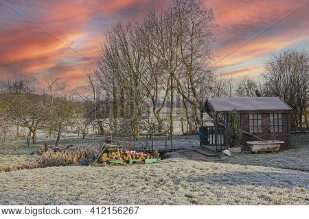 Landscape View Across Large Garden And Fields In Winter At Sunset With Dramatic Sky Frost And Summer
