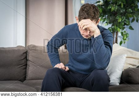 Portrait Of Unhappy Suffering Depressed Guy, Young Frustrated Sad Upset Desperate Man Sit At Home In