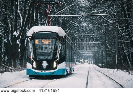 Moscow, Russia - January 31 2021: A Modern Tram Is Driving Along A Snow-covered Alley. Winter Day. I
