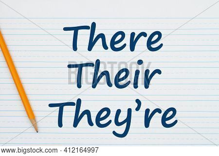There, Their, They're Grammar Rules Message On Retro Lined School Paper With A Pencil