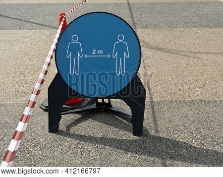 Social Distancing Signboard And Barricade Tape On Sidewalk During The Coronavirus Quarantine